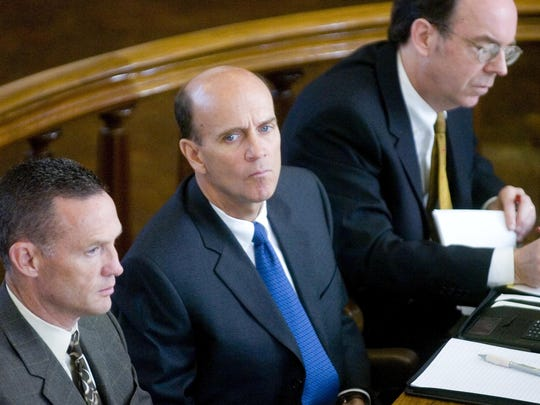 Calvin Harris listens to opening statements during his first murder trial with his attorneys, Joseph F. Cawley Jr., left, and William Easton at Tioga County Court in this 2007 file photo.