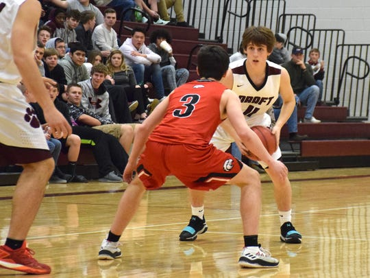 Stuarts Draft's Jacob Taylor looks to pass while being