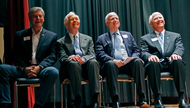 Mississippi Republican Gov. Phil Bryant, from left, joins U.S. Sen. Thad Cochran, R-Miss., U.S. Sen. John McCain, R-Ariz., second from right, U.S. Sen. Roger Wicker, R-Miss., during rally in support of Cochran's re-election, at the Mississippi War Memorial in Jackson, Miss., Monday, June 23, 2014. Cochran faces state Sen. Chris McDaniel, R-Ellisville, Tuesday in a runoff for the GOP nomination for senate.