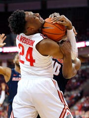 Ohio State Buckeyes forward Andre Wesson fights for