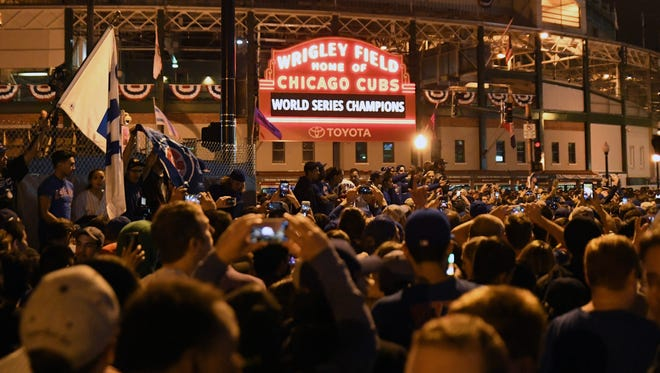 Chicago Cubs fans celebrate after game seven of the 2016 World Series against the Cleveland Indians outside of Wrigley Field. Cubs won 8-7, Nov. 2, 2016, in Chicago.
