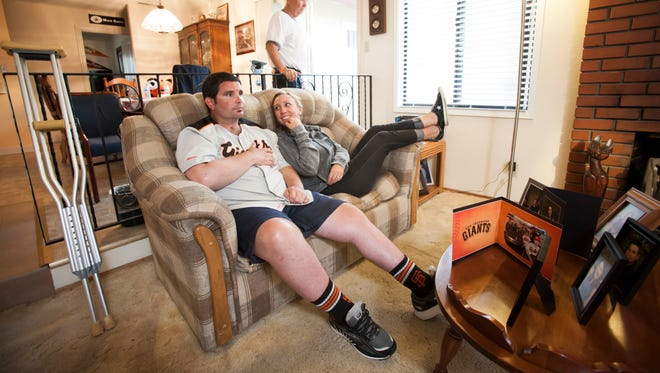 Bryan Stow watches Game 4 of the NLCS with his sister Erin Collins and father Dave in his Capitola, CA home.