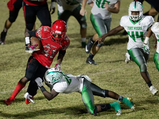 North Fort Myers High SchoolÕs Terry Lindsey gains a first down against Fort Myers on Friday in the regional semifinal playoff game at North Fort Myers. Fort Myers beat North 7-6 and will play Naples in the upcoming regional final.