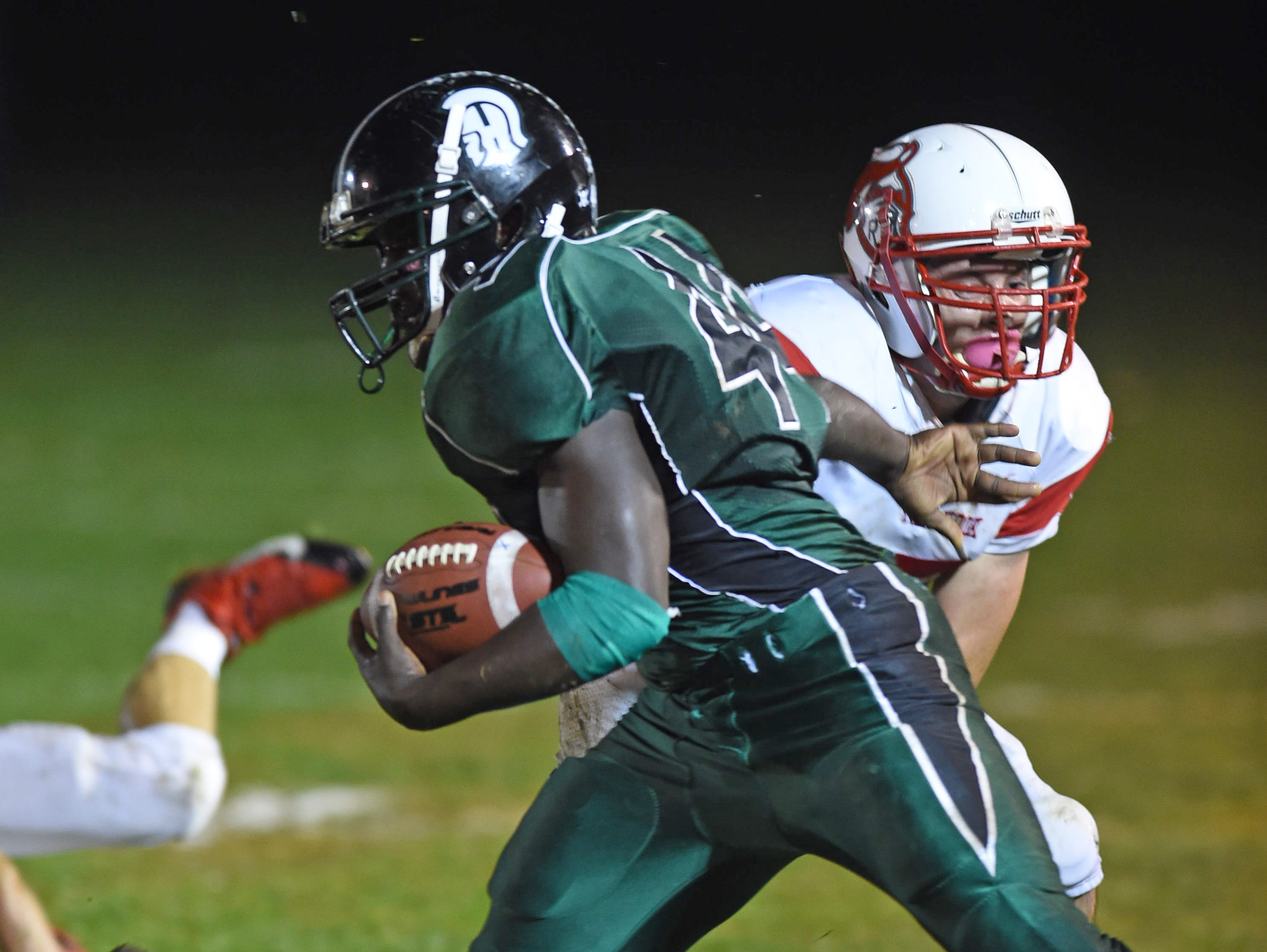 Spackenkill's Dhyquem Lewinson breaks away from Red Hook's Nick Mchitsch during Friday's game in Poughkeepsie.