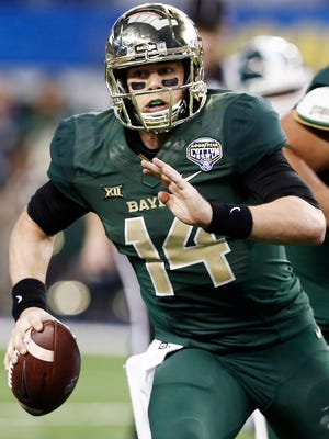 Baylor quarterback Bryce Petty (14) runs the ball during the second half of the Cotton Bowl NCAA college football game against Michigan State, Thursday, Jan. 1, 2015, in Arlington, Texas. Michigan State won 42-41. (AP Photo/Brandon Wade)
