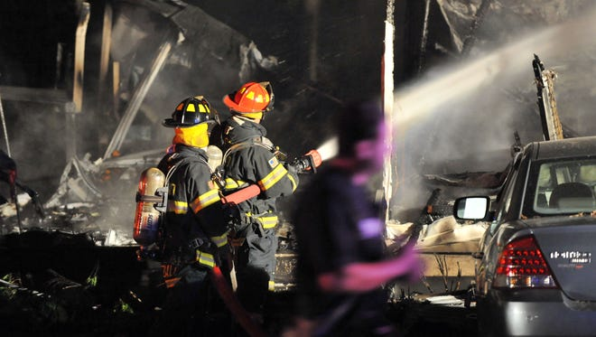 Firefighters work to extinguish a blaze at a mobile home Monday on Fursin Avenue inside Buena Vista Campground.