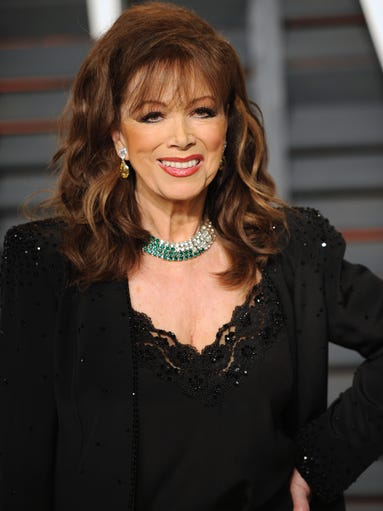 Author Jackie Collins arrives at the 2015 Vanity Fair