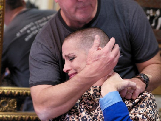 Ricky Boudreaux comforts his wife, Madelene, after