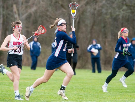 New Oxford's Lauren Slonaker (25) charges down field