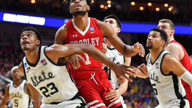 Ari Boya of Bradley battles for position during an NCAA tournament game against Michigan State in Des Moines, Iowa.