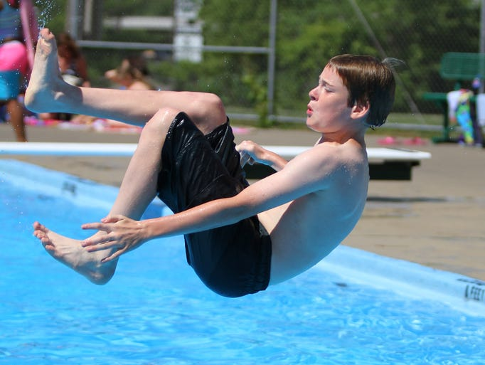 A boy gets ready to plunge into the water on July 5 at the Vestal Memorial Pool. The pool is open every day from noon to 8 pm through Aug. 31.