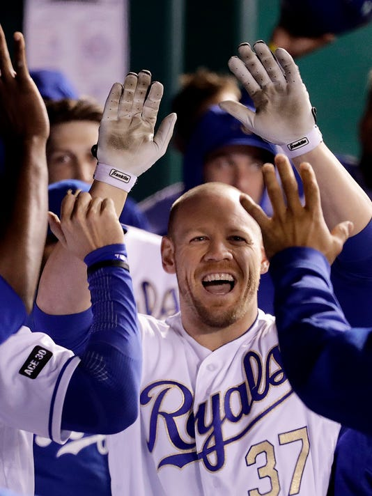 Kansas City Royals' Brandon Moss celebrates in the dugout after hitting a solo home run during the seventh inning of a baseball game against the Minnesota Twins Friday, April 28, 2017, in Kansas City, Mo. (AP Photo/Charlie Riedel)