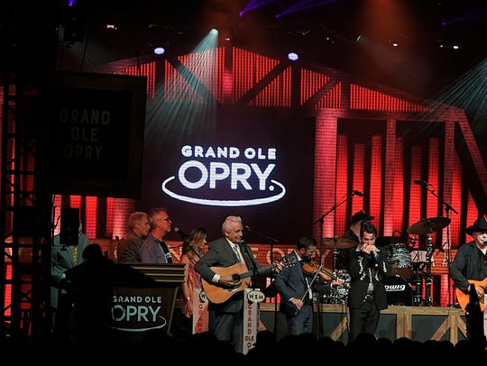 Del McCoury and Bobby Bare sing during the Grand Ole