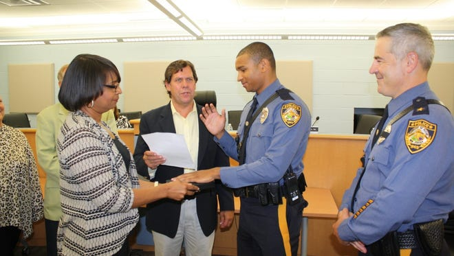 Officer Joseph M. Larkins was sworn in by Mayor Christopher Sciliano Wednesday. His mother, Jonita Larkins, held the Bible as Chief Steven R. Peters looked on.