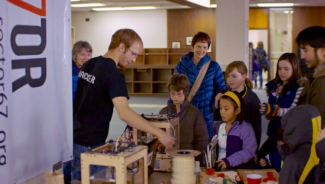 Chris Meyer, founder of maker space Sector67 in Madison, demonstrates innovative technologies for students at a local school.