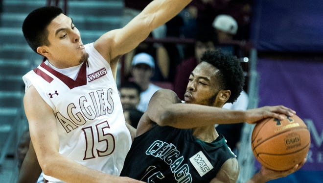 New Mexico State's Joe Garza applies intense pressure on Chicago State's Trayvon Palmer in second half action Saturday night at the Pan American Center. For a photo gallery from Saturday's game, click on this story at lcsun-news.com