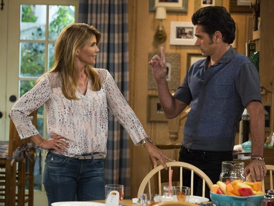 "Lori Loughlin and John Stamos appear in ""Fuller House."""