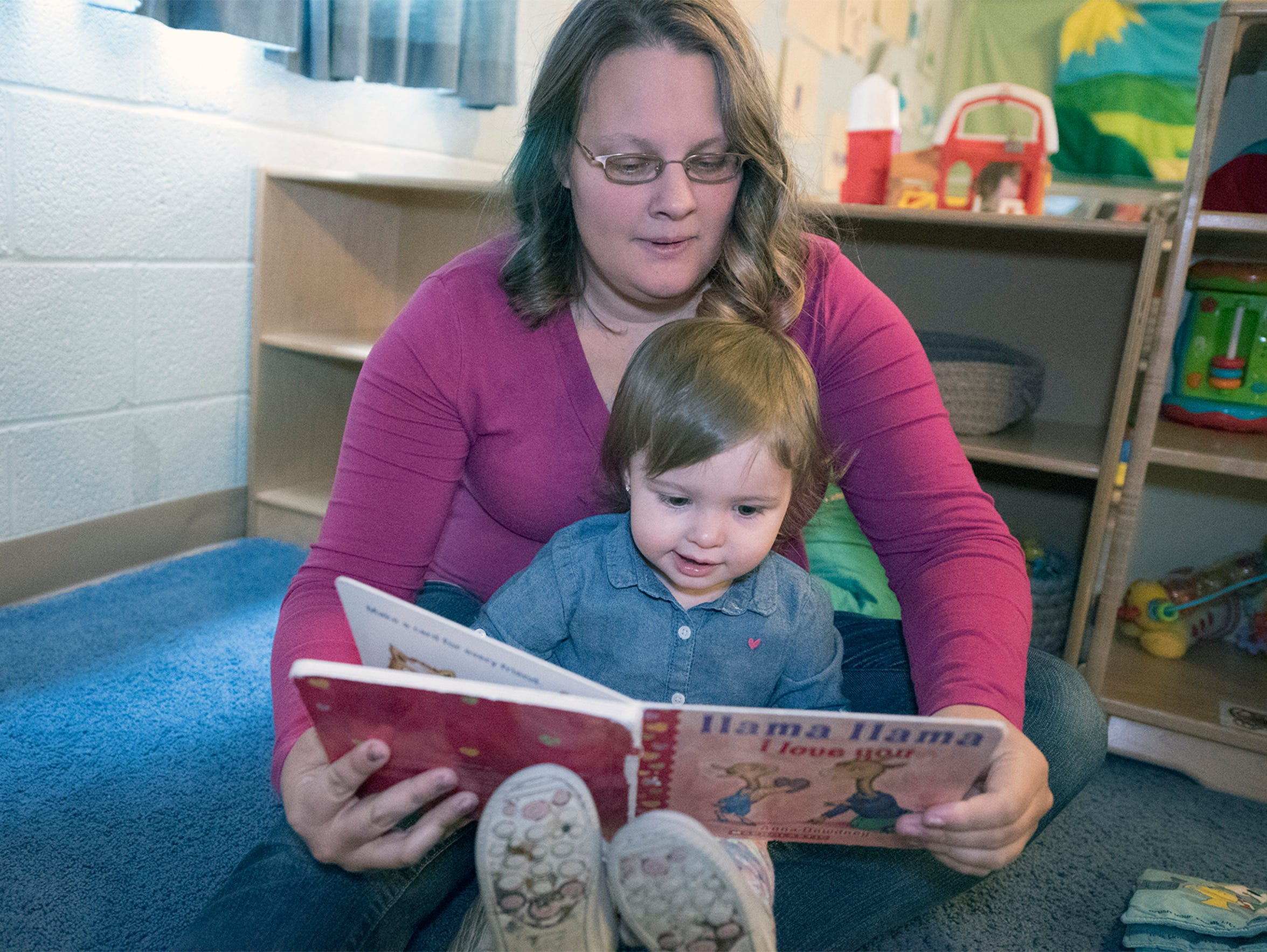 Destini Boxall reads to her daughter, Aislynn, 19-months-old