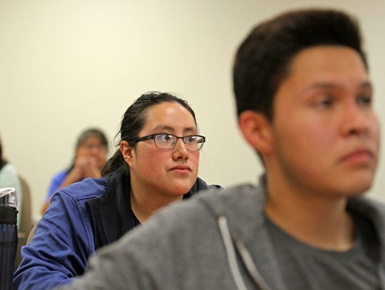 Students listen to a lecture in a precalculus class