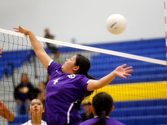 Kirtland Central's Jerica Holiday defends the net on