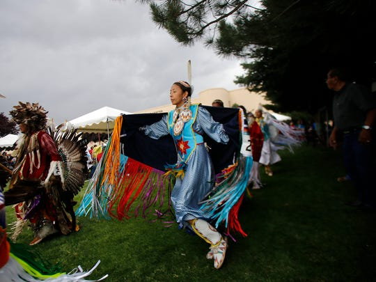 A shawl dancer participates in the grand entry last year during the Totah Festival at the Farmington Civic Center.
