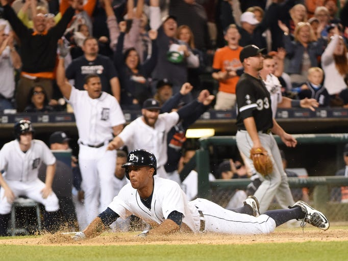 Tigers' Anthony Gose scores on a triple by Rajai Davis
