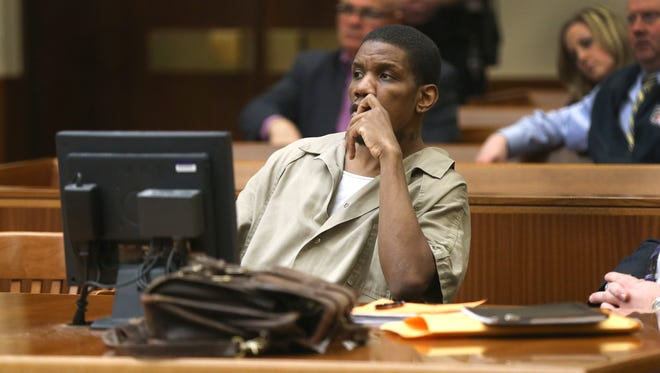 Thomas Johnson III listens in court on March 27.