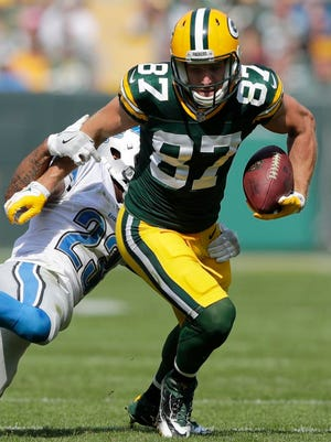 Green Bay Packers receiver Jordy Nelson catches a second quarter pass in the red zone in front of Detroit Lions' Darius Slay.