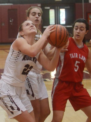Lillie Kloak, here grabbing rebound, and Ridgewood topped Fair Lawn in the first round of the Bergen County tournament.