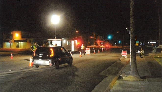 Palm Springs police officers hold a DUI checkpoint on June 20, 2014.
