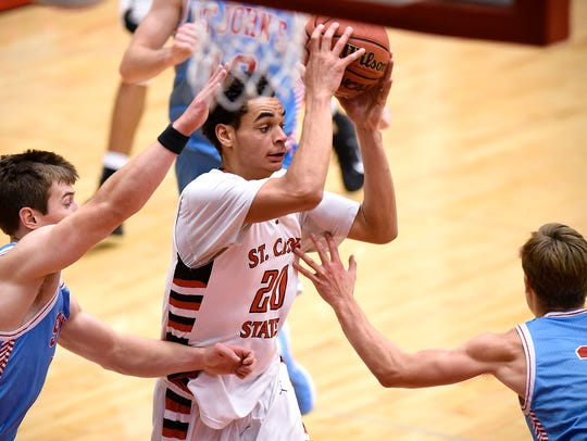 St. Cloud State's Gage Davis drives to the hoop during