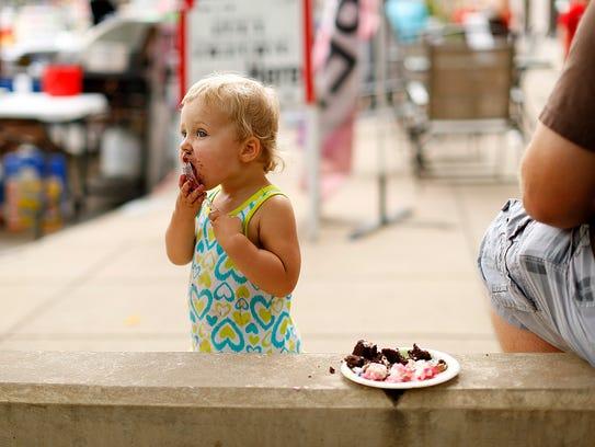 Harper Grenier, 18-months-old, enjoyed a piece of cake