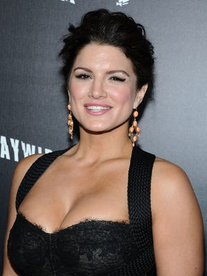 Actress Gina Carano  arrives at Relativity Media's premiere of 'Haywire' co-hosted by Playboy held at DGA Theater on January 5, 2012 in Los Angeles, California.  (Photo by Angela Weiss/Getty Images)