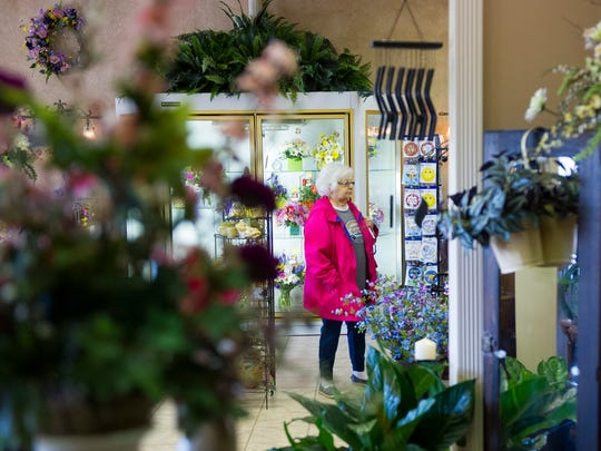 Suizie Tolbert of Evansville, browses through merchandise at Cottage Florist & Gifts in Evansville, Thursday, March 16, 2017. Cottage Florist & Gifts recently moved to their new location in the North Park Shopping Center after 17 years on Lincoln Ave.