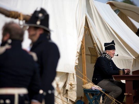 Dudley Hardin smokes his pipe while resting outside his American camp tent during the Battle of New Orleans re-enactment last year at Chalmette Battlefield in Chalmette.