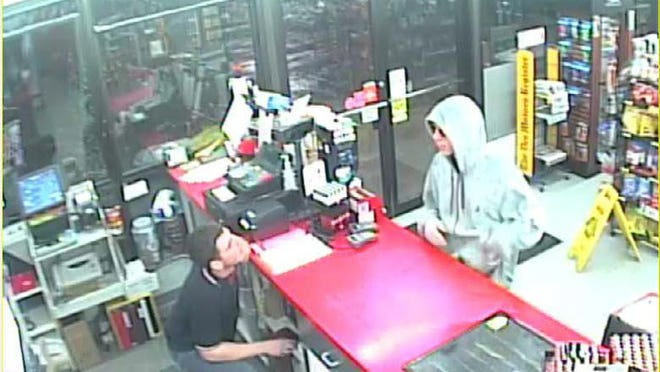 The Polk County Sheriff's Office is looking for this suspect in a Git-N-Go robbery that was reported Sunday night. The suspect was described as an 18-to-22-year-old man who was about 5 feet 9 inches tall and weighed about 150 pounds. He was wearing a gray sweatshirt, blue jeans, sunglasses and gloves, authorities said.
