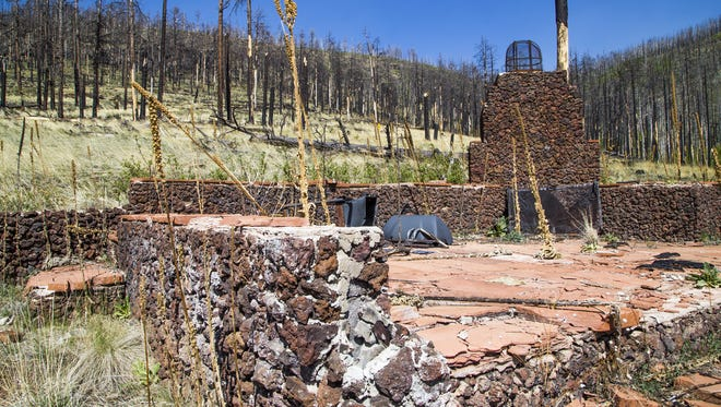 A chimney, fireplace and charred tile is all that is left of this cabin in the East Fork neighborhood of Greer.  The Wallow Fire devastated much of the forest around the town and destroyed some cabins.
