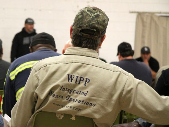 Members of the United Steelworkers listen to Union