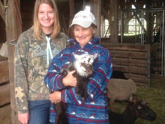 Herding students Kaylee Sirr (left) and Brenda Kuchenbecker