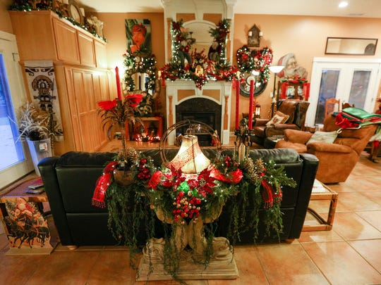 Faux greenery, lights, feathers, birds, faux berries and more cover more than 20 separate arrangements throughout the home of Tom Anderson and Tass Morrison in Sublimity.