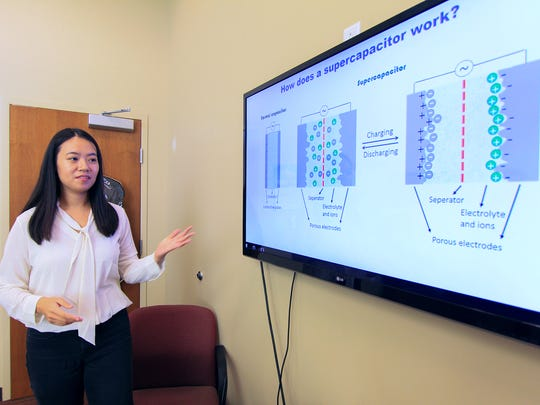 Nanomaterials lab team member Jingyi Zhu, doctoral candidate, explains the improvement of capacitors in an interview Wednesday at the Clemson University Nanomaterials Center near Pendleton.