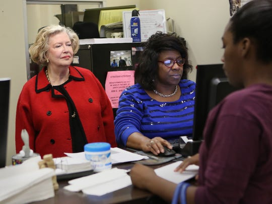 October 14, 2016 - Senior Deputy Clerk Trina Gray (center) assists a customer in the downtown clerks office as City Court Clerk Kay Robilio looks on. Robilio took office this year and will continue the amnesty program through December of this year for some ticketed citizens.