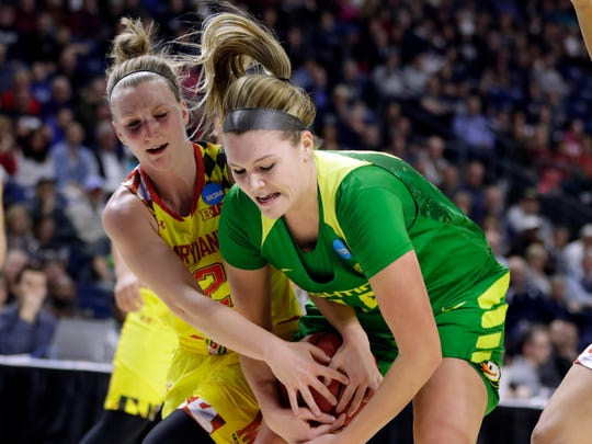 Oregon Ducks forward Mallory McGwire (44) works for the ball against Maryland Terrapins guard Kristen Confroy (12) during the first half in the semifinals of the Bridgeport Regional of the women's 2017 NCAA Tournament at Webster Bank Arena.