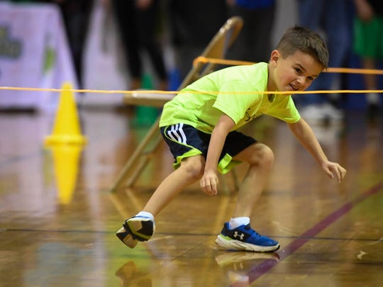 Bend Gate Elementary student Hudson Moore, 6 years-old, makes his way through the obstacle course during the Henderson Breakfast Lions Club Tri-Fest Elementary School Competition Saturday, April 22, 2017.