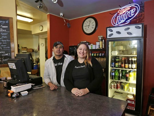 Margarito Perez, left, and Joelle Steffen inside of Nicky's Pizza, Wednesday, January 24, 2018 in Sheboygan, Wis. The couple have decided to put their business on the market.