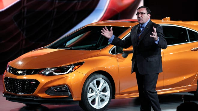 Alan Batey, president of General Motors North America, reveals the 2017 Chevrolet Cruze Hatchback  to the news media at the 2016 North American International Auto Show in Detroit last January