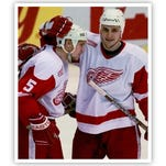 Detroit Red Wings' Sergei Fedorov, right, and Vyacheslav Kozlov (13) congratulate Nicklas Lidstrom (5) after Lidstrom's second-period goal in the Red Wings' 4-2 victory over the Toronto Maple Leafs at Joe Louis Arena in Detroit, Wednesday, Jan. 26, 2000.