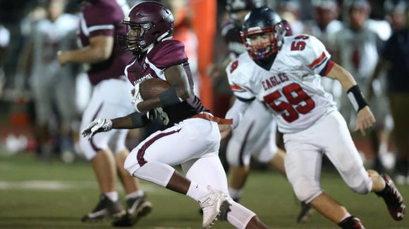 Harrison's Brian Newsome (8) gets the carry during