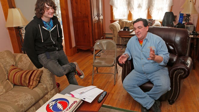 Chris Cavanaugh with his son Cooper, 17, of Ossining, at their home on March 4, 2015. The pair are Grateful Dead fans.