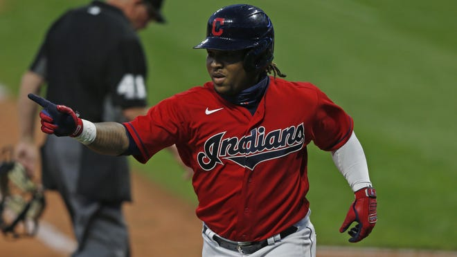 Cleveland Indians' Jose Ramirez celebrates after hitting a two run home run off Cincinnati Reds relief pitcher Cody Reed during the seventh inning of a baseball game at Progressive Field, Thursday, Aug. 6, 2020, in Cleveland. The Indians won 13-0.